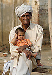 A man and his grandchild in Lahore, Pakistan....