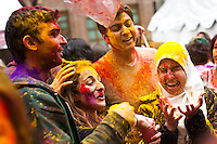 Revellers throw colored powder while they attend the Holi Hai festival organized by Indian community in New York City March 31, 2013. Photo by Eduardo Munoz Alvarez / VIEWpress.