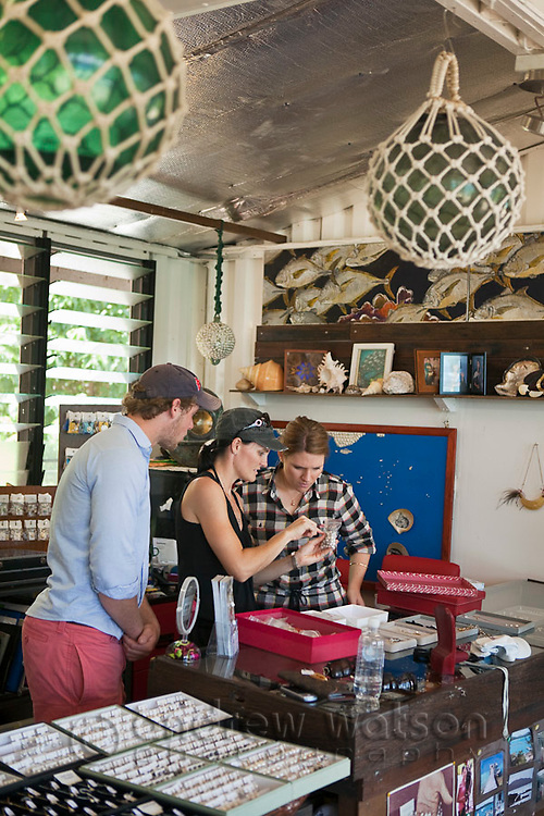 Tourists shop for pearl jewellery at Kazu Pearls.  Friday Island, Torres Strait Islands, Queensland, Australia