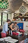 Tourists shop for pearl jewellery at Kazu Pearls.  Friday Island, Torres Strait Islands, Queensland, Australia