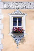 Oriel window sgraffito design on a traditional house in Mustair, Switzerlan