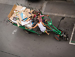 Gypsy (Roma) collect and recycle cardboard from dumpsters in the street below Miloje's apartment on Nisca Street, Belgrade, Serbia