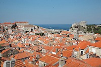 View over the rooftops of the medieval walled city, Dubrovnik, Croatia, with the Lovrijenac Fortress and Adriatic Sea in the distance. The city developed as an important port in the 15th and 16th centuries and has had a multicultural history, allied to the Romans, Ostrogoths, Byzantines, Ancona, Hungary and the Ottomans. In 1979 the city was listed as a UNESCO World Heritage Site. Picture by Manuel Cohen