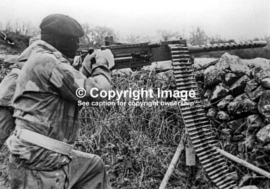 This republican movement press release photograph claims to be of a Provisional IRA border unit on manoeuvres in Co Fermanagh, N Ireland, February 1977. The volunteer in this picture is using a Browning M2 50mm machine gun. 197702130024d<br /> <br /> Copyright Image distributed by Victor Patterson, 54 Dorchester Park, Belfast, UK, BT9 6RJ<br /> <br /> Tel: +44 28 9066 1296<br /> Mob: +44 7802 353836<br /> Voicemail +44 20 8816 7153<br /> Email: victorpatterson@me.com<br /> <br /> <br /> IMPORTANT: If you wish to use this image or any other of my images please go to www.victorpatterson.com and click on the Terms &amp; Conditions. Then contact me by email or phone with the reference number(s) of the image(s) concerned.