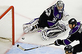 Jonathan Quick (Los Angeles Kings, #32) and Rob Scoderi (Los Angeles Kings, #7) watching puck going wide of goal during ice-hockey match between Los Angeles Kings and Colorado Avalanche in NHL league, Februar 26, 2011 at Staples Center, Los Angeles, USA. (Photo By Matic Klansek Velej / Sportida.com)