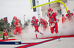 Liberty Flames Football players take to the field against Coastal Carolina University on Oct. 19, 2013.