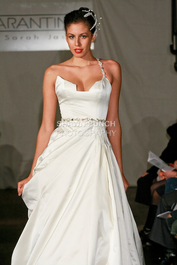 Model walks the runway in a Maria wedding dress - double face silk sating with pearl and Swarovski Crystals - by Sarah Jassir for the SARANTINA by Sarah Jassir Spring 2011 runway show, during New York Bridal Week Spring 2011.