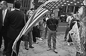 New Yorkers, and visitors from all over the world, stop on lower Broadway to look at the smouldering buildings of the World Trade Centre complex, and to remember and pay tribute to the victims of the September 11th 2001 terrorist attack on the World Trade Centre buildings in Lower Manhattan by AL-Qaeda terrorists, New York, United States of America.
