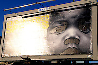 These anti-abortion billboards suddenly appeared all over Atlanta. They had been haunting me all day, seemingly staring at me from every corner, when I drove by this one, the light was hitting it fantastically. I was returning from a photo shoot with a women who had taken me to where her daughter was raped two years earlier so that I could photograph her there for a story. She cried to me as I took pictures, she described her 17 year old daughter being raped in an abandoned building.