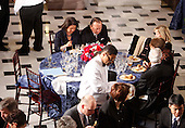 """Washington, DC - January 20, 2009 -- United States Senator Daniel Inouye (Democrat of Hawaii), top center, sitting beside his wife Irene, finishes eating at a luncheon for President Barack Obama at Statuary Hall in the U.S. Capitol  in Washington, Tuesday, January 20, 2009. Sharing the table with Senator Inouye were United States Senator Robert Bird (Democrat of West Virginia) and United State Senator Edward M. """"Ted"""" Kennedy (Democrat of Massachusetts). Both had to leave the luncheon due to health reasons. .Credit: Lawrence Jackson - Pool via CNP"""