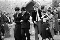 Pix: Copyright Anglia Press Agency/Archived via SWpix.com. The Bamber Killings. August 1985. Murders of Neville and June Bamber, daughter Sheila Caffell and her twin boys. Jeremy Bamber convicted of killings serving life...copyright photograph>>Anglia Press Agency>>07811 267 706>>..Jeremy Bamber is comforted by his girlfriend Julie Mugford at the funeral of his family, alongside Colin Caffell, father and husband of victims. no date..ref 0006 neg 16