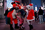 A woman poses for a picture in Times Square as she takes part during the SantaCon party in New York, United States. 15/12/2012. Photo by Kena Betancur/VIEWpress.