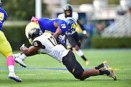Newark, DE - OCT 29, 2016: Towson Tigers defensive back Keon Paye (12) makes a tackle on Delaware Fightin Blue Hens running back Thomas Jefferson (28) during game between Towson and Delaware at Delaware Stadium Tubby Raymond Field in Newark, DE. (Photo by Phil Peters/Media Images International)