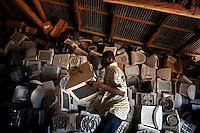 Computer monitors are piled high at a importers warehouse in Accra, Ghana. The majority of them are not working and will be scrapped.