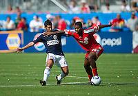 August 07 2010 Chivas USA midfielder Paulo Nagamura #26 and Toronto FC midfielder Joesph Nane #15 in action during a game between Chivas USA and Toronto FC at BMO Field in Toronto..Toronto FC won 2-1.