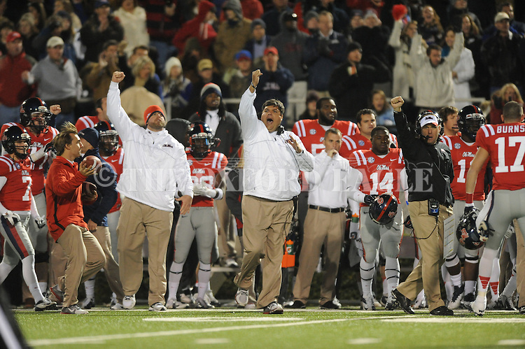 Ole Miss assistant coach Matt Luke and Ole Miss Coach Hugh Freeze react to the Rebels stopping Mississippi State on 4th down at Vaught Hemingway Stadium in Oxford, Miss. on Saturday, November 24, 2012. Ole Miss won 41-24.