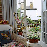 Looking from the living room out through the French windows into the courtyard garden