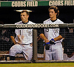8 September 2006: Jamey Carroll, second baseman for the Colorado Rockies (left), and outfielder Jeff Salazar (right) watch a play from the dugout during a game against the Washington Nationals. The Rockies defeated the Nationals 10-5 in a rain-delayed game at Coors Field in Denver, Colorado. ..Mandatory Photo Credit: Ed Wolfstein..