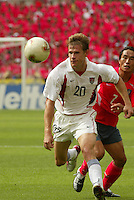 Brian McBride eyes the ball. The USA tied South Korea, 1-1, during the FIFA World Cup 2002 in Daegu, Korea.