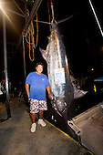 Bomboy LLanes poses with Pacific Blue Marlin Grander at the Honokohau Harbour