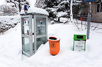 Switzerland. Canton Bern. Wengen. Snow in the winter. Swisscom public phone booth. Orange and green dustbin. Wengen is a mountain village in the Bernese Oberland of central Switzerland. Located in the canton of Bern at an elevation of 1,274 m (4,180 ft) above sea level, it is part of the Jungfrauregion and has approximately 1,300 year-round residents. 14.01.17 © 2017 Didier Ruef