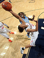 CHARLOTTESVILLE, VA- JANUARY 5: Simone Egwu #4 of the Virginia Cavaliers reaches for the rebound with Laura Broomfield #33 of the North Carolina Tar Heels during the game on January 5, 2012 at the John Paul Jones arena in Charlottesville, Virginia. North Carolina defeated Virginia 78-73. (Photo by Andrew Shurtleff/Getty Images) *** Local Caption *** Simone Egwu;Laura Broomfield
