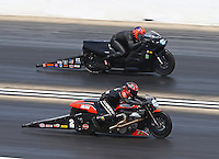 Jul 10, 2016; Joliet, IL, USA; NHRA pro stock motorcycle rider Eddie Krawiec (near) races alongside Michael Phillips during the Route 66 Nationals at Route 66 Raceway. Mandatory Credit: Mark J. Rebilas-USA TODAY Sports