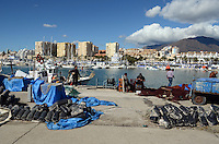 Fishermen repair fishing nets, quay, Mediterranean, Mediterraneo, Estepona, Malaga, Andalucia, Andalusia, Spain, Espana, Costa del Sol, tourism, travel, holidays, 201302201116..Copyright Image from Victor Patterson, 54 Dorchester Park, Belfast, UK, BT9 6RJ..Tel: +44 28 9066 1296.Mob: +44 7802 353836.Voicemail +44 20 8816 7153.Skype: victorpattersonbelfast.Email: victorpatterson@me.com.Email: victorpatterson@ireland.com (back-up)..IMPORTANT: If you wish to use this image or any other of my images please go to www.victorpatterson.com and click on the Terms & Conditions. Then contact me by email or phone with the reference number(s) of the image(s) concerned.