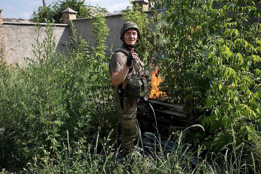 UKRAINE, Pisky: Vladimir is checking a phosphorus bomb that was just launch in the garden of his rear base.<br /> <br /> UKRAINE, Pisky: Vladimir v&eacute;rifie une bombe phosphore qui vient tomber dans le jardin de sa base arri&egrave;re.