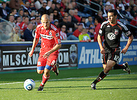 Chicago midfielder Freddie Ljungberg (8) dribbles toward the goal with DC United defender Jed Zayner (12) in pursuit.  The Chicago Fire tied DC United 0-0 at Toyota Park in Bridgeview, IL on Oct. 16, 2010.