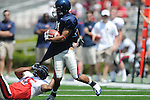 Blue team receiver Lionel Breaux (21) is tackled by Red team defender Demareo Marr (15)in Mississippi's Grove Bowl in Oxford, Miss. on Saturday, April 17, 2010. The play was called back because of penalty.