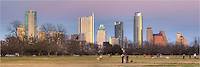 Just before sunset, Zilker Park is alive with activity. In the distance, the high rises of Austin stand watch over the park.