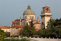 General view of the back of the church of San Giorgio in Braida, 11th-16th century, Verona, Italy, seen from the Ponte Pietra in the early morning. In the 11th century it was a Benedictine monastery but was totally redeveloped in the 16th century. The dome was designed by Michele Sanmicheli. The 12th century Bell Tower is the only remnant of the earlier church on the site. Picture by Manuel Cohen.