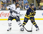 Phil DeSimone (UNH - 39), Jordan Heywood (Merrimack - 4) - The Merrimack College Warriors defeated the University of New Hampshire Wildcats 4-1 (EN) in their Hockey East Semi-Final on Friday, March 18, 2011, at TD Garden in Boston, Massachusetts.