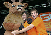 Freshers' Fair helpers with the Union mascot introducing new students to university Clubs, University of Surrey.