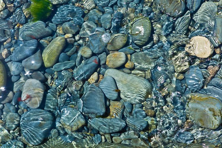 Tidal sea water covers rocks and stone shingle, Kilkee, County Clare, West Coast of Ireland