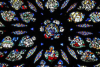 Rose window of the Upper chapel of La Sainte-Chapelle (The Holy Chapel), 1248, Paris, France. The gothic 16th century rose window shows the Apocalypse around an enthroned Christ in the central oculus. La Sainte-Chapelle was commissioned by King Louis IX of France to house his collection of Passion Relics, including the Crown of Thorns. The Sainte-Chapelle is considered among the highest achievements of the Rayonnant period of Gothic architecture, the most famous features are the great stained glass windows. Picture by Manuel Cohen