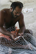 Tokinteiti Nikora mends his fishing nets, in the village of Tenoraereke, on the island of Kiribati in the Pacific Ocean. The islands, and their way of life, are endangered by rising sea water levels which are eroding the fragile atoll, home to approximately 92,000 people.
