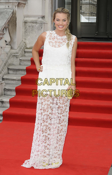 Margot Robbie<br /> attended the &quot;About Time&quot; UK film premiere to open Somerset House's Film4 season of outdoor cinema, Somerset House, the Strand, London, England, UK, 8th August 2013.<br /> full length white crochet lace sheer dress sleeveless long maxi hand on hip gold clutch bag <br /> CAP/CAN<br /> &copy;Can Nguyen/Capital Pictures