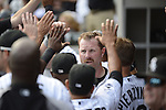 CHICAGO - SEPTEMBER 17:  Adam Dunn #32 of the Chicago White Sox celebrates with teammates after scoring against the Detroit Tigers on September 17, 2012 at U.S. Cellular Field in Chicago, Illinois.  The White Sox defeated the Tigers 5-4.  ((Photo by Ron Vesely)  Subject:  Adam Dunn