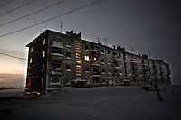Lights shine from the last occupied flat in an apartment block in Yor Shor. Established beyond the Arctic Circle, where temperatures in winter drop to -50C, most of its population left after the closure of its Soviet-era coal mine. Many of those who remain are being evicted by the regional authorities who want to save money by shutting off supplies of gas and electricity. Russia's far north is slowly declining. Every year thousands of people from its towns and cities flee south. The system of subsidies that propped up Siberia and the Arctic in Soviet times has crumbled. Now there is no advantage to living in the far north, salaries are no higher than in central Russia and prices for goods are higher. /Felix Features