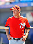 28 February 2011: Washington Nationals' Manager Jim Riggleman watches his team take batting practice prior to a Spring Training game against the New York Mets at Digital Domain Park in Port St. Lucie, Florida. The Nationals defeated the Mets 9-3 in Grapefruit League action. Mandatory Credit: Ed Wolfstein Photo