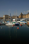 Boats moored in the marina of the Neuchatel harbour, on the lake Neuchatel. Switzerland.
