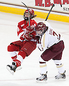 Jessica Campbell (Cornell - 8), Dru Burns (BC - 7) - The Boston College Eagles defeated the visiting Cornell University Big Red 4-3 (OT) on Sunday, January 11, 2012, at Kelley Rink in Conte Forum in Chestnut Hill, Massachusetts.