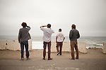 Danny Hess, far right, and his friends check out the waves at Ocean Beach, San Francisco, on Wednesday, July 7, 2011.