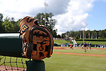 31 May 2016: A glove is placed on the railing in front of the Nova Southeastern dugout. The Nova Southeastern University Sharks played the Lander University Bearcats in Game 8 of the 2016 NCAA Division II College World Series  at Coleman Field at the USA Baseball National Training Complex in Cary, North Carolina. Nova Southeastern won the game 12-1.