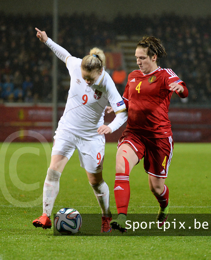 20151130 - LEUVEN ,  BELGIUM : Belgian Maud Coutereels (R) and Serbian Marija Radojicic (L)  pictured during the female soccer game between the Belgian Red Flames and Serbia , the third game in the qualification for the European Championship in The Netherlands 2017  , Monday 30 November 2015 at Stadion Den Dreef  in Leuven , Belgium. PHOTO DIRK VUYLSTEKE