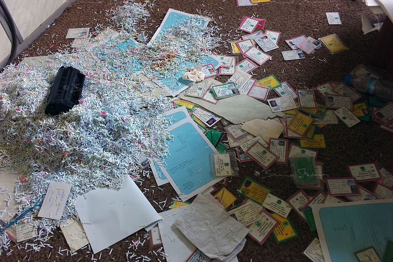 Tripoli, Libya, August 26, 2011.Archives of an elite militia unit inside the Bab Aziziya compound, it seems the previous occupant of the office didn't have time to finish shredding all the documents....