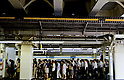 Tokyo, Japan - Many people is seen on the platform at Shinjuku Station. Morning commuters typically spend over one hour on the train going to work. Trains are usually so packed that train platform staff have to push commuters to fit in the train so that the doors can close shut. (Photo by Yumeto Yamazaki/AFLO)