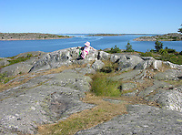 Child Enjoying View of Archipelago on Island of Kökar, Åland, Finland